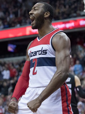 Wizards guard John Wall celebrates during the second half of the NBA game between the Washington Wizards and LA Clippers.