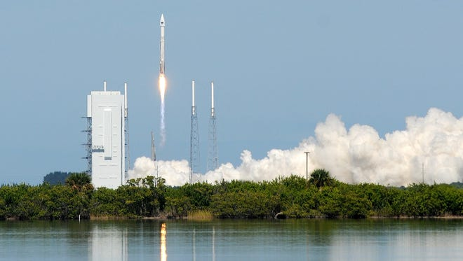 A United Launch Alliance Atlas V rocket lifts off from Cape Canaveral Air Force Station, Fla., on Wednesday, Oct. 29, 2014. The rocket is carrying a GPS satellite.