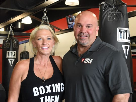 Jennifer and Michael Johnson run Title Boxing Club in Naples. The Club offers kickboxing and boxing classes for all levels and another session tailored to people with Parkinson's disease.