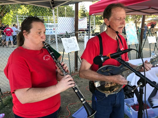 Joy Stander, left, and John Tiedeman of the Neighborhood