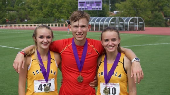 Tuscola's Jacob Franklin, center, was an individual