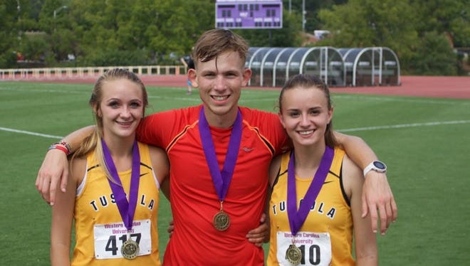 Tuscola's Jacob Franklin, center, was an individual winner at Saturday's Freedom Invitational in Morganton.