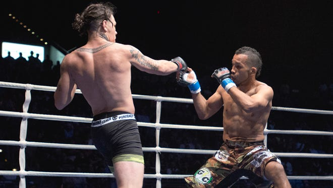 Brok Weaver, left, battles with Elvin Brito at Island Fights 33 on March 27, 2015 at the Bay Center. Weaver is in the main event of Island Fights 37 on Friday at the Bay Center.
