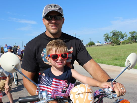 Easy riders Rob Galusha and his son, Slade, 2, motored