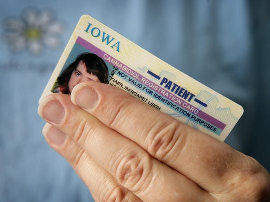 Sally Gaer holds her daughter Margaret's medical cannabis patient card in West Des Moines. The state of Iowa paid $115,000 to create the cards.