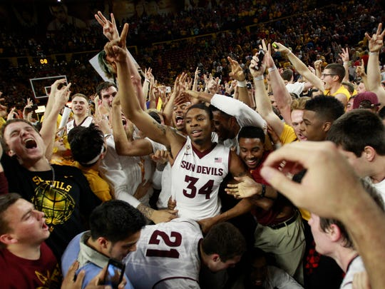 ASU players and fans celebrate after beating Arizona 69-66 in double OT at Wells Fargo Arena in Tempe on Feb. 14, 2014.