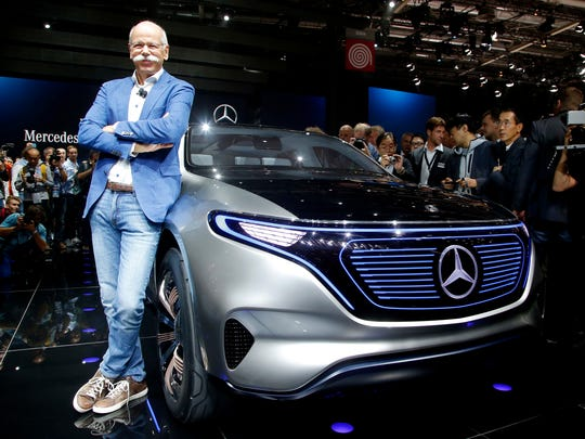 Dieter Zetsche, CEO of Daimler AG, stands next to the