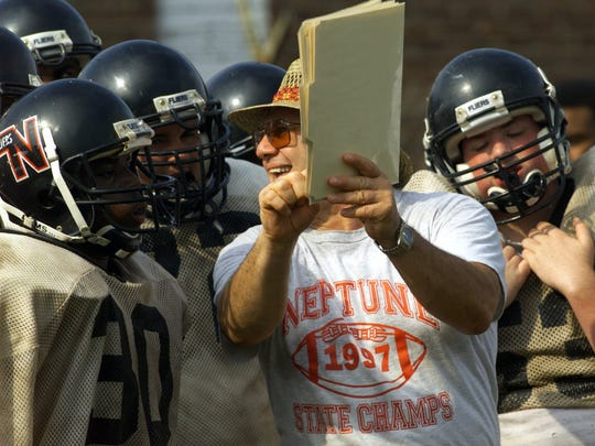Neptune head coach John Amabile led the Scarlet Fliers to unbeaten, untied seasons in both 1995 and 1997.