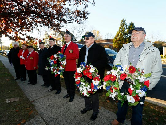 Memorial and Veterans Day Association of Morristown and Morris Township's annual Veterans Day services starting with laying of wreaths and Honor Guard salute at J. Robert Tracey Veterans Memorial Park. November 11, 2017. Morristown, New Jersey