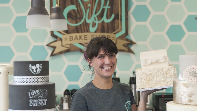Cara Griffin is surrounded by her sweet creations at Sift Bakeshop, a bakery that opened recently on  White Horse Pike in Haddon Township.