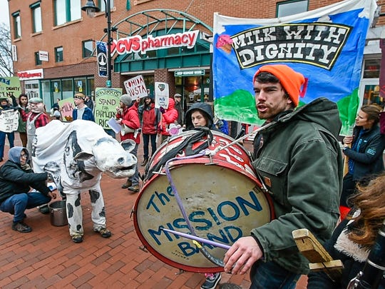 Members of Migrant Justice demonstrate outside the Ben & Jerry's scoop shop in Burlington during the ice cream company's Free Cone Day on Tuesday, April 4, 2017.