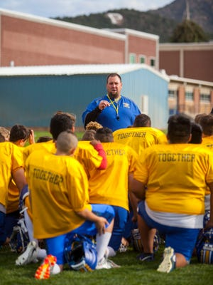 Carter Miller, Parowan football's head coach, talks to his team at the end of practice on Tuesday, September 27, 2017.