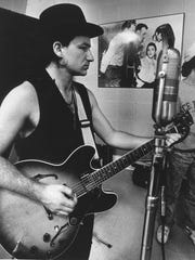 "Bono, lead singer of U2, performs during a recording session at Sun Studios on Union on Nov. 2, 1987. Elvis Presley made his first recordings at Sun. The band recorded three songs for its ""Rattle and Hum"" album in the studio."