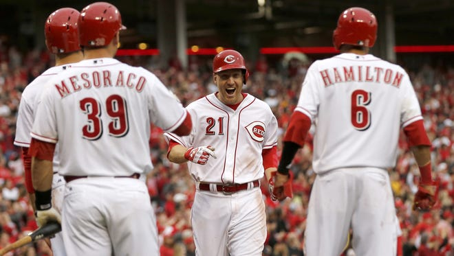 Reds third baseman Todd Frazier (21) celebrates his Opening Day home run.