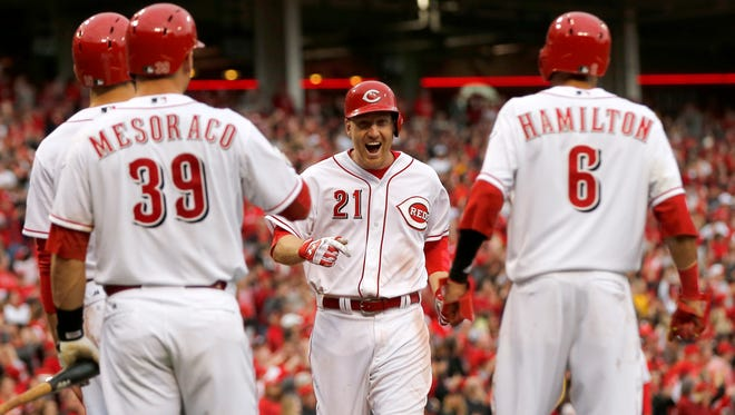 Reds third baseman Todd Frazier had so many memorable moments throughout the 2015 season, namely winning the Home Run Derby. But, for me, one of the most memorable moments is when hit the go-ahead three-run home run to lift the team over the Pittsburgh Pirates on Opening Day. In this photo, he smiles as he scores, perfectly sandwiched between his teammates that he drove in.