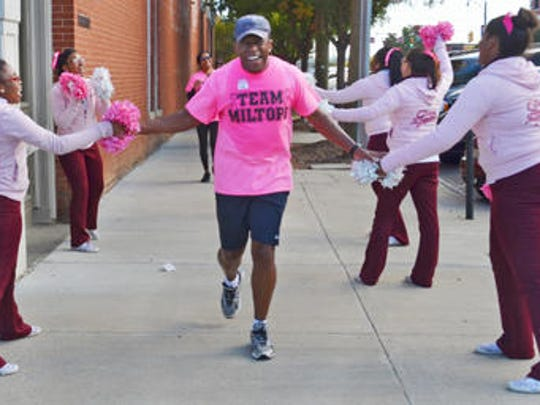"""Ed Crowell crosses the finish line during the """"Making Strides Against Breast Cancer"""" event Saturday in Montgomery in 2013."""