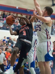 Northeastern's Austin Green (3) shoots the ball against