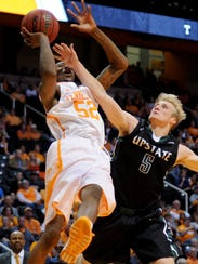 USC Upstate's Ty Greene blocks a shot by Tennessee's