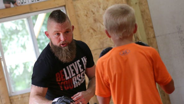 "Cody ""The Wolverine"" Stevens instructing a youth striking"