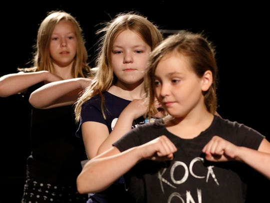 Capitol Civic Center's theater arts camp participant Melayna Wardall practice dance moves with her teammates Emile Wardall, left, Talyn Hammer and Olivia Hagen at UW-Manitowoc on Tuesday, June. 21. Twenty-six kids have participated the week-long theater camp at UW-Manitowoc on Tuesday, June 21.