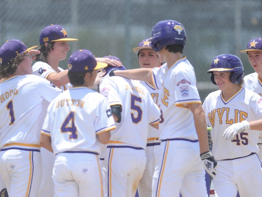 Wylie players congratulate teammate Dash Albus (5)