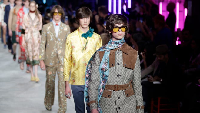 Models wear creations for Gucci men's Spring-Summer 2016 collection, part of the Milan Fashion Week, unveiled in Milan, Italy, Monday, June 22, 2015.
