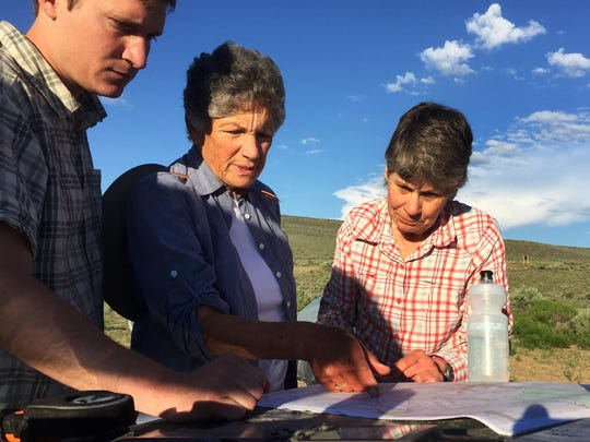 Jeremy Austin of the Oregon Natural Desert Association reviews maps of northern Nevada and southern Oregon with Julie Weikel and Helen Harbin before the latter two embarked on a cross counry hike from Sheldon National Wildlife Refuge.