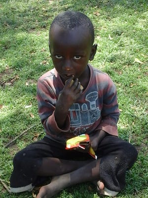 A child eats biscuit in the town of Kataba near Kampala, Uganda, on August 22, 2017. Children here continue to live in constant fear of being kidnapped and sacrificed.