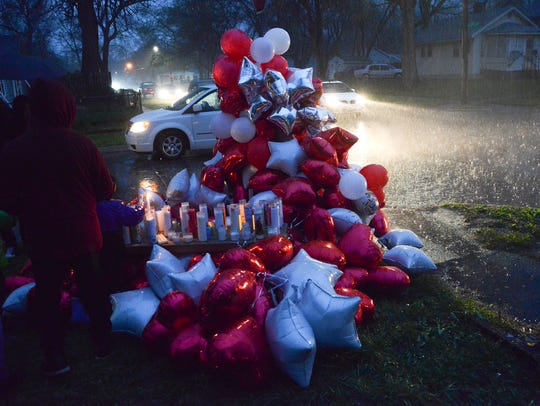 Mourners placed balloons and candles at East 30th Street
