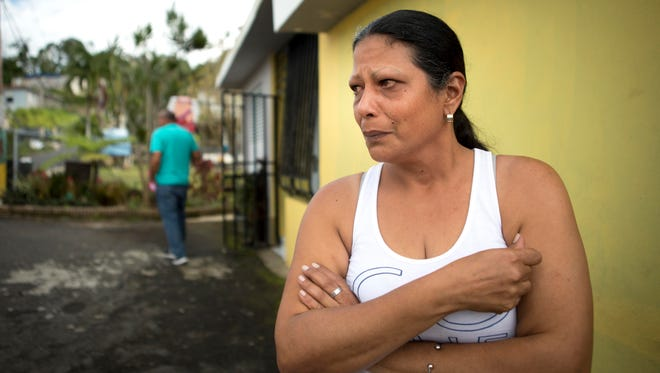 Magdaliz Medina has been without electricity and running water since Hurricane Irma -- two weeks before Maria. She collects water in plastic barrels in her carport, some of which contain floating, dead mosquitos. She uses that water for bathing and washing dishes and buys bottled water to drink.