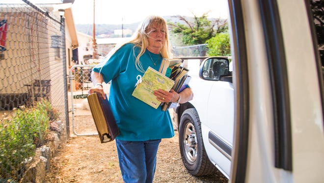 Eveline Sandy evacuates her home in Mayer as the Goodwin Fire approaches, Tuesday, June 27, 2017.