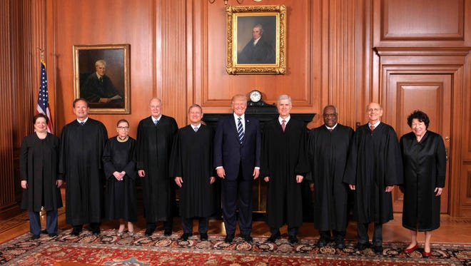 U.S. Supreme Court justices with President Trump.