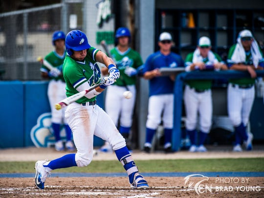 Barron Collier graduate Marc Coffers takes his cuts during a game last month. Coffers made an immediate impact to the FGCU lineup before a wrist injury sidelined him.