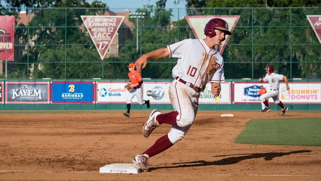 Taylor Walls scored the first run for the Seminoles against the Cougars.