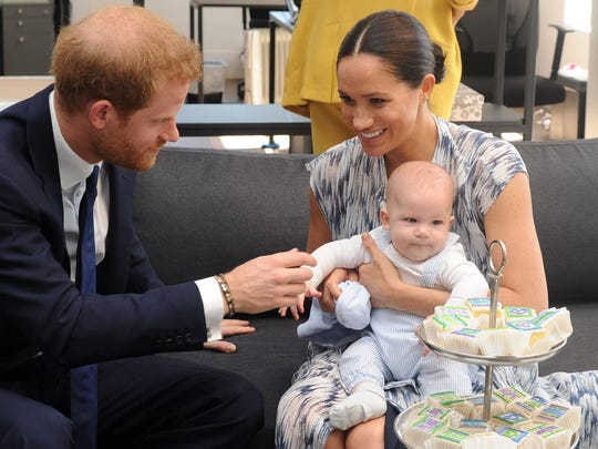 Harry, Meghan and Archie.   (Photo by HENK KRUGER / AFP)
