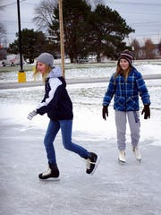 Theresa Homeier and Maddie Aloi at the Webster Rec rink.