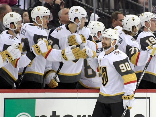 Vegas Golden Knights left wing Tomas Tatar (90) celebrates his goal with teammates during the second period of an NHL hockey game against the New Jersey Devils, Sunday, March 4, 2018, in Newark, N.J. (AP Photo/Bill Kostroun)