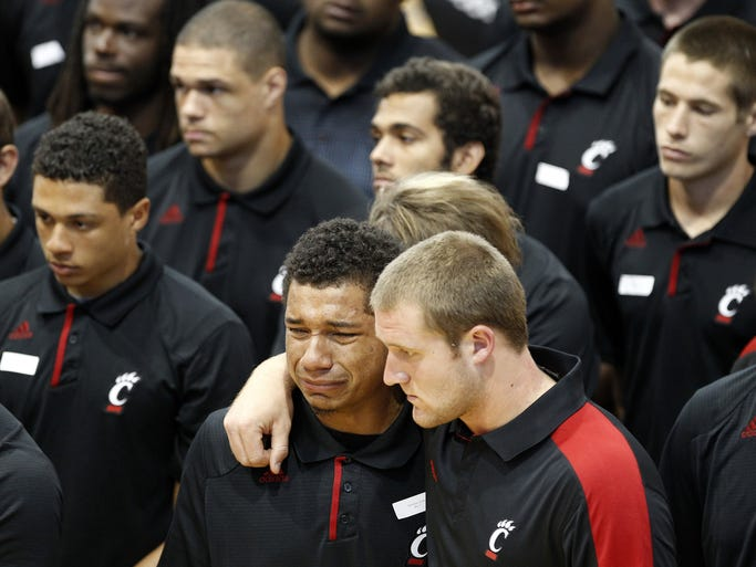 Members of the University of Cincinnati football team mourn during a memorial service for Ben Flick, 19, who died in a car crash in Hanover Twp. The memorial service was held September 24, 2013 at Hamilton High where Flick was a standout on the football team.