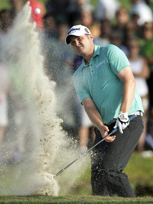 Xavier grad Jason Kokrak blasts out of the sand trap on the 17th hole at the Arnold Palmer Invitational in 2014. Kokrak finished fourth.