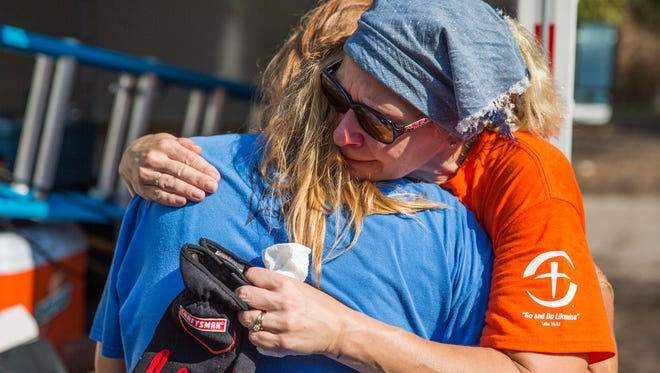 Amy Morenus, a volunteer with Samaritan's Purse, embraces Bonita Springs resident Lori Malone outside her damaged home Tuesday, Sept. 26, 2017. Morenus came from New York to help those affected by Hurricane Irma.