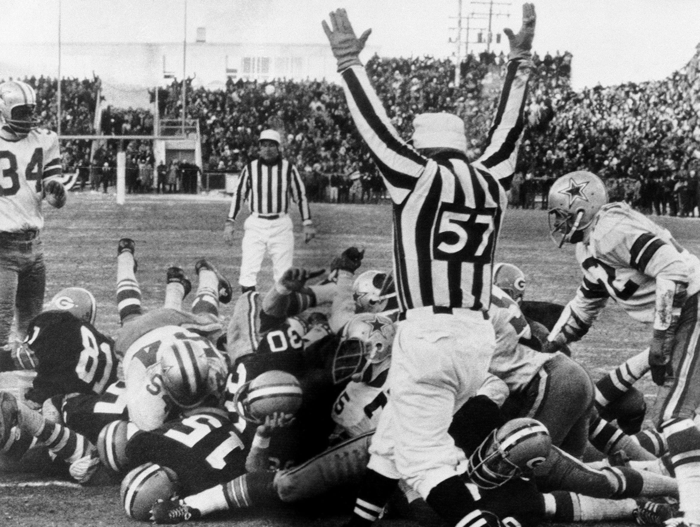 Bart Starr (15) sneaks into the end zone for the winning touchdown in the Green Bay Packers' 21-17 victory over the Dallas Cowboys in the 1967 NFL Championship Game, better known as the Ice Bowl, on Dec. 31, 1967 at Lambeau Field.