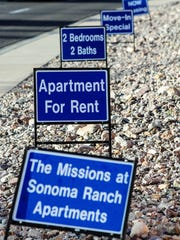 Signs are posted along Sonoma Ranch Blvd. on Tuesday advertising apartment availability for The Missions at Sonoma Ranch.