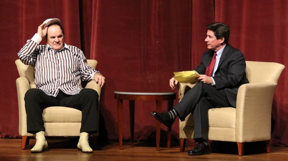 Former Reds player and manager Pete Rose (left) talks with host and Enquirer columnist Paul Daugherty during a lecture on ethics in sport Monday on the campus of Miami University in Oxford.