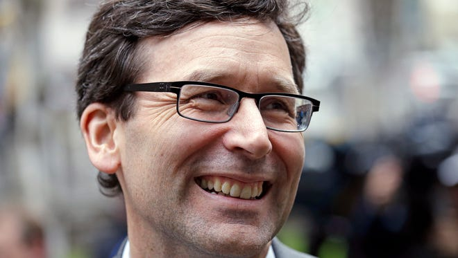Washington State Attorney General Bob Ferguson smiles as he speaks with the media on the steps of the federal courthouse after an immigration hearing there on March 15, 2017, in Seattle.