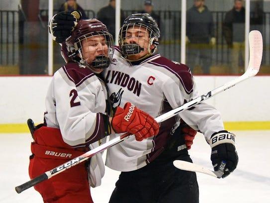 Lyndon's Krystof Vanek, right, gets a hug from teammate