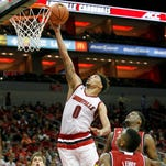 University of Louisville's Damion Lee (0) fights to get his shot off under pressure from Louisville's defense during their Red-White Intrasquad scrimmage at the KFC Yum! Center in Louisville, Kentucky.       October 3, 2015