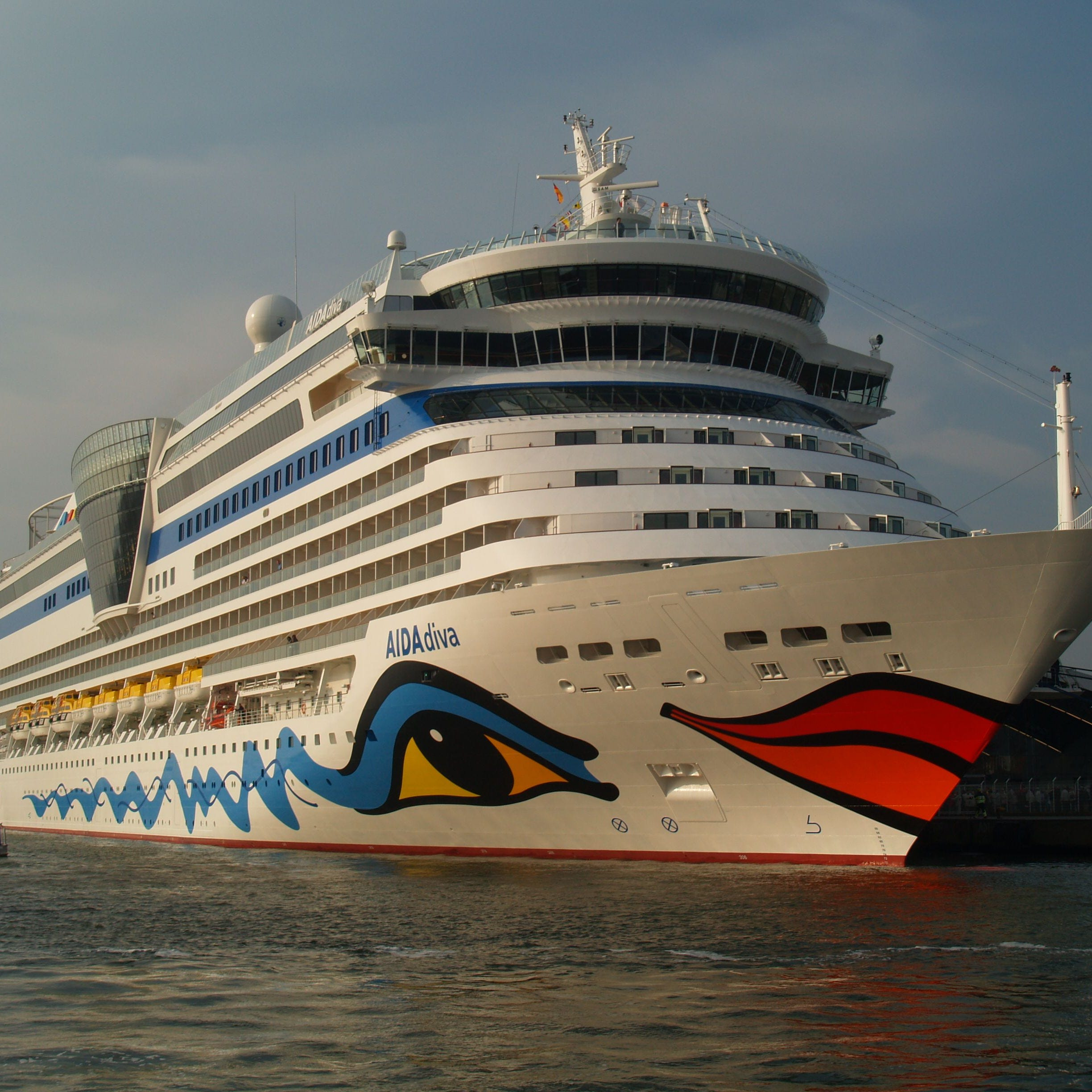 Yes, those are giant red-and-orange lips on the front of a cruise ship. German line Aida Cruises has made the multi-deck-high lips on its ship hulls a signature. Aida is credited with starting the hull art trend way back in the 1990s.