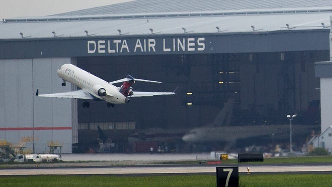 A Delta Air Lines plane takes off at Atlanta's Hartsfield International Airport in Atlanta, Monday, Aug. 8, 2016, as Delta Air Lines grounded all flights after after a power outage hit its computer systems globally. Delta began limited flights amid global computer shutdown; thousands of passengers are stranded with many cancellations and delays are ongoing. (AP Photo/Branden Camp) ORG XMIT: GABC104