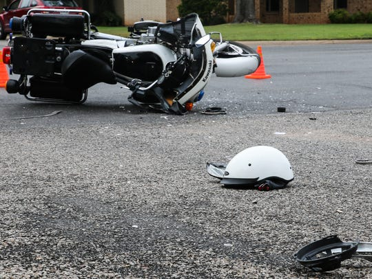 A private escort motorcycle was involved in a crash