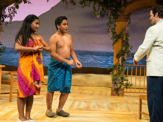Tava Maddison LaRaine Lutui (left) is Ngana, and Jonah Lee Palelei Lutui is Jerome, and Michael Scott Harris is Emile de Becque as they perform a scene at the Utah Shakespeare Festival's production of South Pacific.